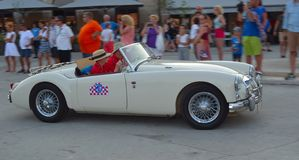 Classic White MGA  being driven through town square in Rovinj in tour of Croatia. Stock Image