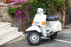 Classic white Piaggio retro scooter stands parked Royalty Free Stock Photos