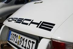 Classic white Porche up close. Rearend. 1971 Porsche 911 S/T 2.5 liter twin plug. outdoors, natural sunlight Stock Photo