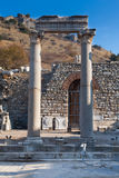 Classic White Roman Pillars at fallen Temple Door with statue de. Corated stone in ephesus Archaeological site in turkey Stock Photography