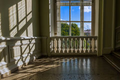 Classic white window with balustrade. With sunlight on wall and green summer tree behind Stock Photos