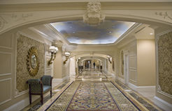 Classic wide corridor with settee and carpet Royalty Free Stock Photos