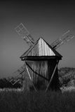 Classic windmill. Classic old-fashioned wooden windmill in field royalty free stock images