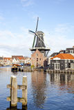 Classic windmill at canal Royalty Free Stock Image