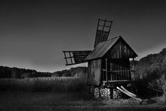 Classic windmill in Romania. Black and white photo of classic windmill in Romania stock image