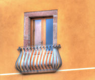 Classic window in a colorful wall Royalty Free Stock Images