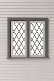Classic window frame with bars  on white Royalty Free Stock Photos