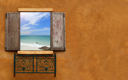 Classic window looking out to sea and blue sky Stock Images
