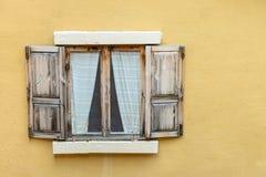 Classic window on yellow wall Stock Photos