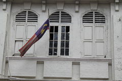 Classic windows building with Malaysia National flag Stock Photo