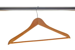 Classic Wood Clothes Hanger on Coat Closet Bar Royalty Free Stock Photo