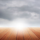 Classic Wood floor and rainclouds for background Stock Image
