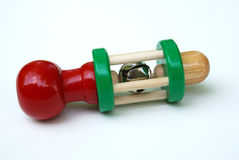 Classic wooden baby rattle Stock Photos
