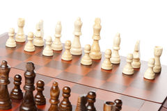 Classic Wooden Chessboard with Chess Pieces Stock Photo