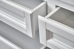 White wooden chest of drawerse. Close-up Stock Photography