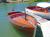 Classic Wooden Chris Craft. This is a well maintained classic wooden Chris Craft speed boat. Beside it is another Chris Craft designed for cruising and fishing royalty free stock image
