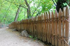Classic Wooden fence with no nails, screws Royalty Free Stock Image