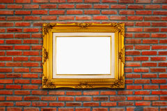 Classic wooden frame on red brick wall background. Royalty Free Stock Images