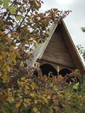 A classic wooden house with fall foliage Royalty Free Stock Image