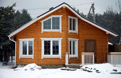 Classic wooden house in rural city. On winter time Royalty Free Stock Photos