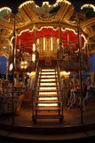 Classic wooden merry-go-round. Night view of merry-go-round with wooden horses in Paris Stock Images