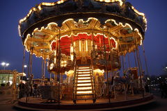 Classic wooden merry-go-round. Night view of merry-go-round with wooden horses in Paris Stock Image