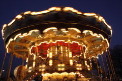 Classic wooden merry-go-round. Night view of merry-go-round with wooden horses in Paris with speed effect Stock Photo