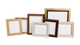 Classic wooden picture frames with blank canvas isolated. On white background stock photography