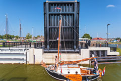 Classic wooden sailing boat passing the Stavoren sluice with ope Royalty Free Stock Images