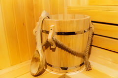 Classic wooden sauna inside. Detail of bucket  in a sauna. Stock Photo