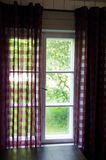 Classic wooden window. Beautiful classic window with green garden view Royalty Free Stock Image