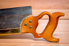 Classic Woodworkers backsaw on a table Stock Photography