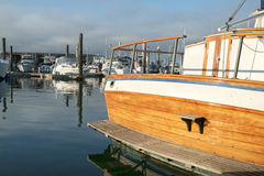 Classic yacht stern. Stern of classic styled wooden yacht with calm waters in marina at Des Moines, Washington Royalty Free Stock Photo