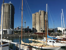 Classic yachts mooring in Wynyard Quarter in Auckland New Zealan. Landscape view of Classic yachts mooring in Wynyard Quarter against Auckland skyline from Silo Stock Images