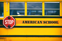 Classic yellow american school bus transporting children to the Stock Photography