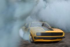Classic Yellow And Black Sports Car Drifting On Road With Smoke stock photography