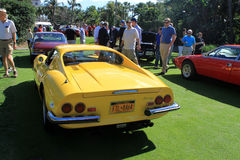 Classic yellow italian sports cars rear side view. Rear side view. classic yellow dino 246 gt sports car.  lined up at 2012 cavallino concorso deleganza at the Stock Photos