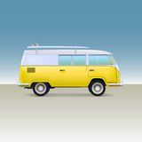 Classic yellow minivan with surfboard. Vintage bus Stock Photo