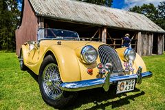 Classic yellow Morgan Sports Car in Fagan Park, NSW, Australia stock image