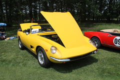 Classic yellow sports car convertible Stock Photos