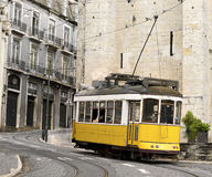 Classic yellow tram of Lisbon, Portugal. Historic classic yellow tram of Lisbon built partially of wood navigating, narrow, winding streets, Portugal Royalty Free Stock Images