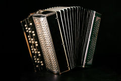 Classical accordion. On a black background royalty free stock photos
