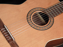 Classical/acoustic guitar. Closup image of a classical guitar royalty free stock photo