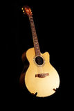 Classical acoustic guitar. Guitar on black isolated background Royalty Free Stock Images