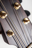 Classical acoustic guitar closeup Stock Images