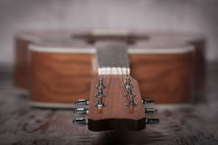 Classical acoustic guitar with fingerboard. Acoustic guitar closeup in perspective - includes strings, fingerboard stock image