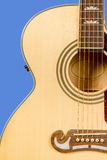 Classical acoustic guitar fragment with six strings and soundboard rosette. Detail of classic acoustic wooden guitar with six strings and soundboard socket brown Royalty Free Stock Photo