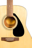 Classical acoustic guitar fragment with strings and soundboard rosette. Detail of classic acoustic wooden guitar with strings and soundboard socket brown Royalty Free Stock Photography