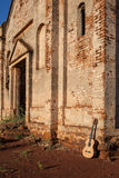 Classical acoustic guitar in ruins of abandoned church Royalty Free Stock Photos