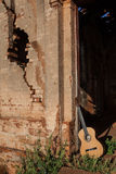 Classical acoustic guitar in ruins of abandoned church Royalty Free Stock Photo